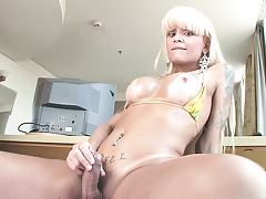 Hot shemale plays w/ her hard cock and sucks another to cum!