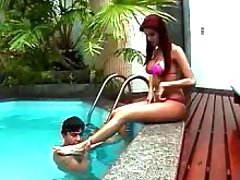 Busty shemale seduces guy near pool
